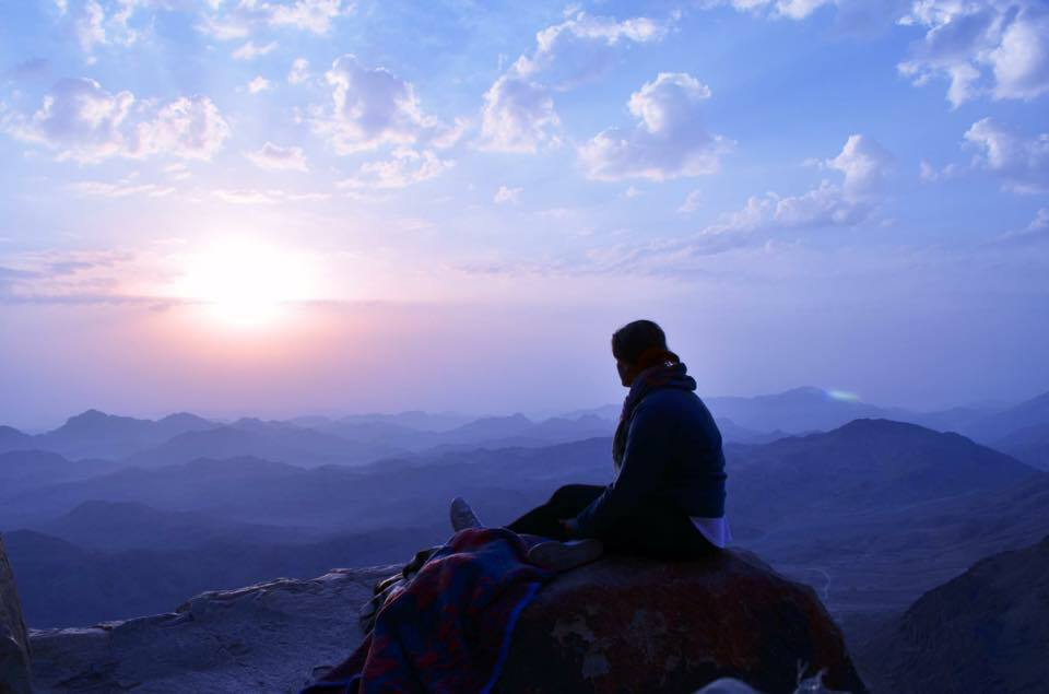 Oneata meditating at sunrise on Mt. Sinai.